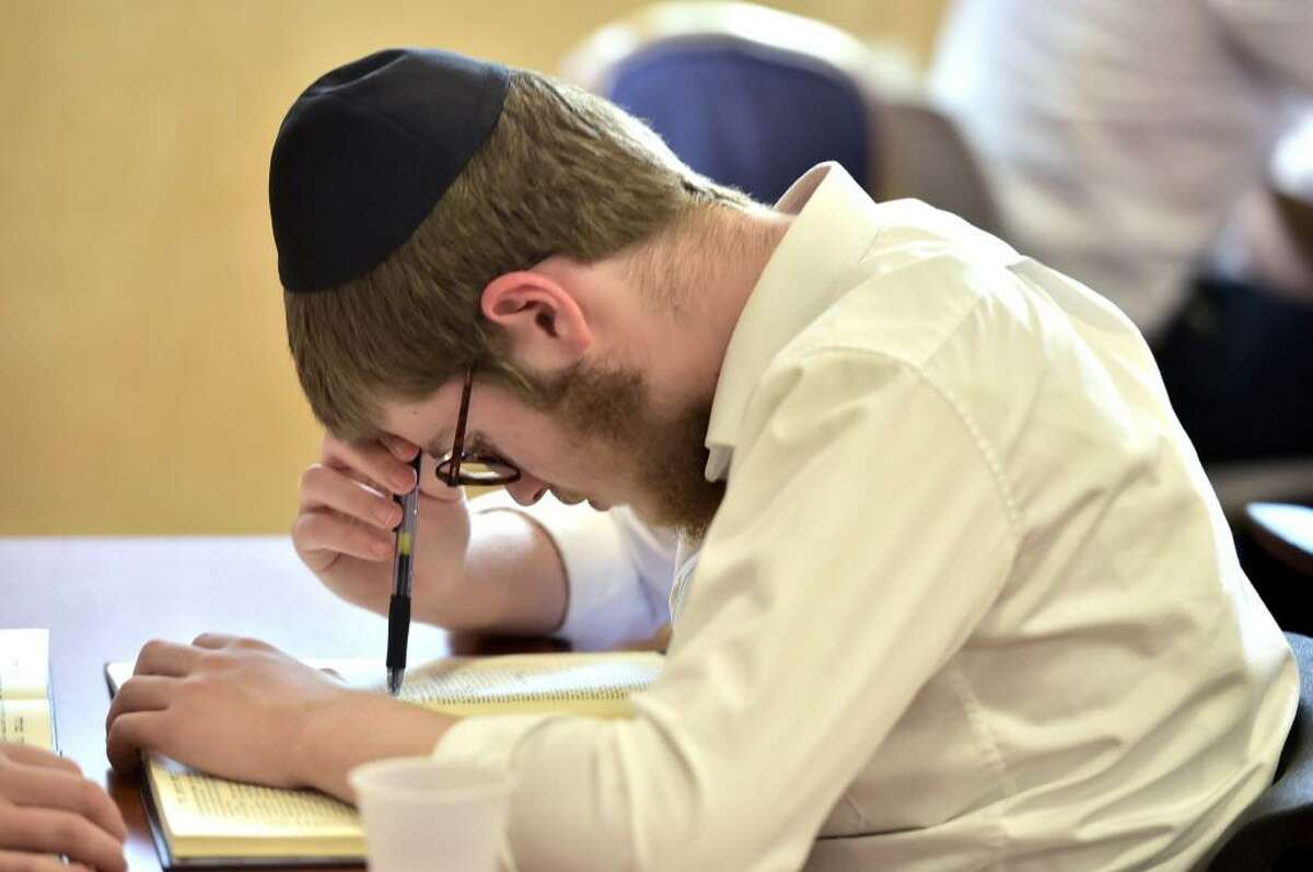 Jewish high school students at the Yeshivas Beis Dovid Shlomo of New Haven study during a summer session at the Norton Street school in New Haven.