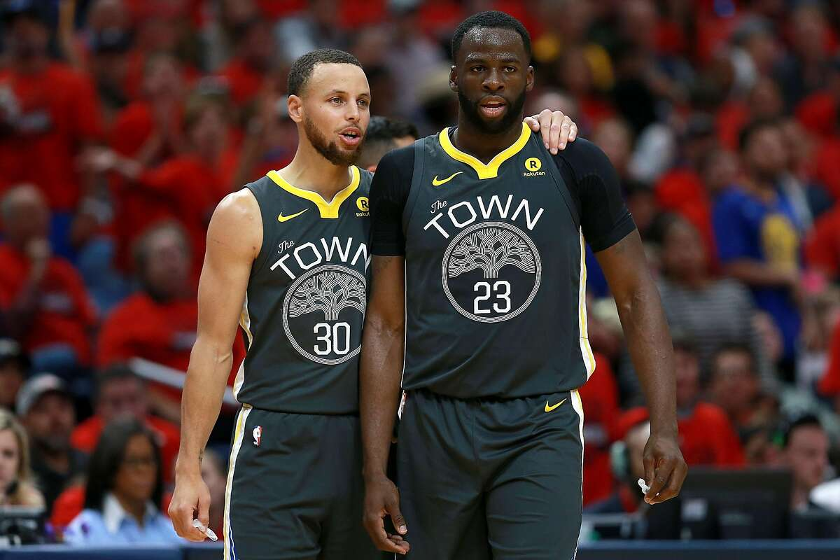 NEW ORLEANS, LA - MAY 06: Stephen Curry #30 of the Golden State Warriors stands on the court with Draymond Green #23 of the Golden State Warriors during the first half of Game Four of the Western Conference Semifinals of the 2018 NBA Playoffs at the Smoothie King Center on May 6, 2018 in New Orleans, Louisiana. NOTE TO USER: User expressly acknowledges and agrees that, by downloading and or using this photograph, User is consenting to the terms and conditions of the Getty Images License Agreement. (Photo by Sean Gardner/Getty Images)