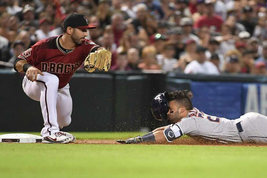 PHOENIX, AZ - MAY 06:  Jose Altuve #27 of the Houston Astros dives into third infront of Daniel Descalso #3 of the Arizona Diamondbacks for a triple in the sixth inning of the MLB game against the Arizona Diamondbacks at Chase Field on May 6, 2018 in Phoenix, Arizona.  (Photo by Jennifer Stewart/Getty Images) Photo: Jennifer Stewart, Stringer / 2018 Getty Images