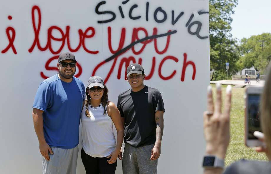 Jose (from left) and Carissa Munoz with Carissa's brother, Calvin Martinez, pose for a photo in Roosevelt Park while attending Síclovía on Sunday. Photo: Edward A. Ornelas /San Antonio Express-News / © 2018 San Antonio Express-News