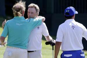 Bernhard Langer, center, hugs his playing partners Miguel Angel Jimenez, left, and Tom Pernice Jr. on the 18th green after Langer won the Insperity Invitational at the The Woodlands Country Club Sunday, May 6, 2018, in The Woodlands, TX. (Michael Wyke / For the  Chronicle)