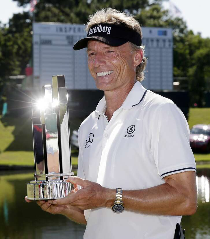 Bernhard Langer poses with the trophy during  the presentation ceremony after winning the Insperity Invitational at the The Woodlands Country Club Sunday, May 6, 2018, in The Woodlands, TX. (Michael Wyke / For the  Chronicle)