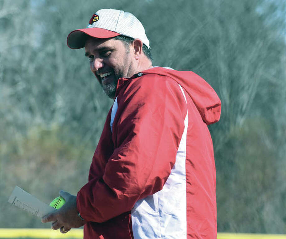 Alton coach Dan Carter joined an exclusive group of the region's prep softball coach Friday when the Redbirds defeated EA-WR for No. 400 in his career. Photo:       Matthew Kamp / Hearst Newspapers