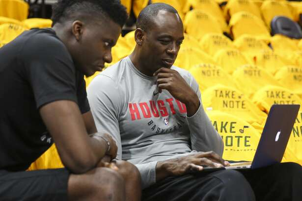 Houston Rockets assistant coach Roy Rogers talks with Houston Rockets center Clint Capela (15) before Game 4 of the NBA second-round playoff series at Vivint Smart Home Arena Sunday, May 6, 2018 in Salt Lake City. (Michael Ciaglo / Houston Chronicle)