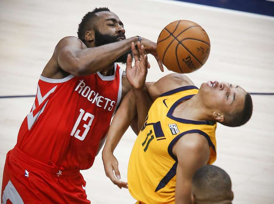 Houston Rockets guard James Harden (13) collides with Utah Jazz guard Dante Exum (11) as he goes to the basket during the first half of Game 4 of the NBA second-round playoff series at Vivint Smart Home Arena Sunday, May 6, 2018 in Salt Lake City. (Michael Ciaglo / Houston Chronicle) Photo: Michael Ciaglo/Houston Chronicle