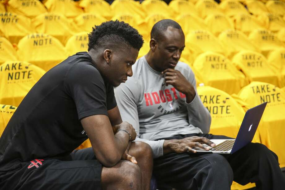 Houston Rockets assistant coach Roy Rogers talks with Houston Rockets center Clint Capela (15) before Game 4 of the NBA second-round playoff series at Vivint Smart Home Arena Sunday, May 6, 2018 in Salt Lake City. (Michael Ciaglo / Houston Chronicle) Photo: Michael Ciaglo/Houston Chronicle