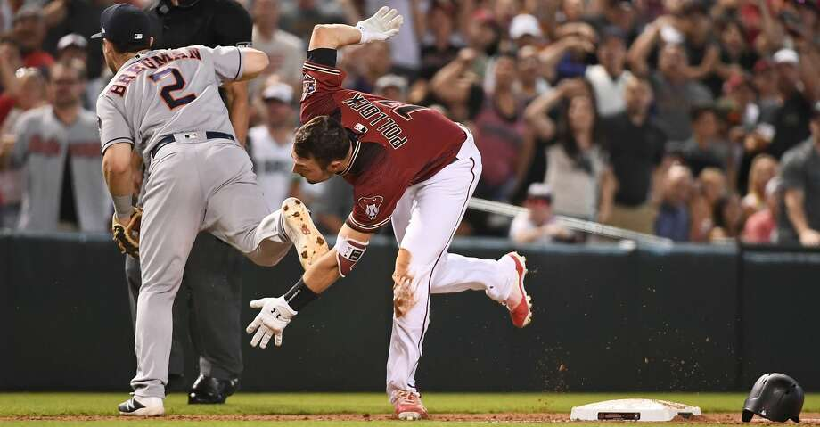 PHOENIX, AZ - MAY 06:  A.J. Pollock #11 of the Arizona Diamondbacks runs home to score on an interference error by Alex Bregman #2 of the Houston Astros in the sixth inning of the MLB game at Chase Field on May 6, 2018 in Phoenix, Arizona.  (Photo by Jennifer Stewart/Getty Images) Photo: Jennifer Stewart/Getty Images