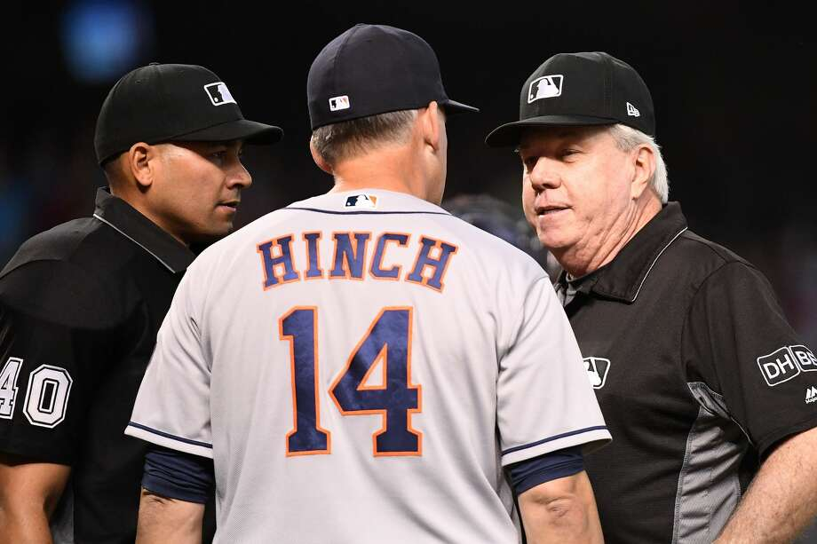PHOENIX, AZ - MAY 06:  AJ Hinch #14 of the Houston Astros talks with umpires Roberto Ortiz #40 and Brian Gorman #9 during the sixth inning of the MLB game against the Arizona Diamondbacks at Chase Field on May 6, 2018 in Phoenix, Arizona.  (Photo by Jennifer Stewart/Getty Images) Photo: Jennifer Stewart/Getty Images