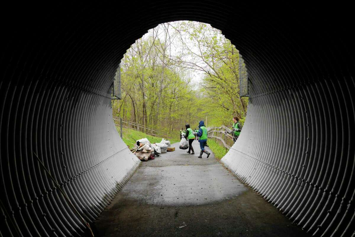 Volunteers from the World Mission Society Church of God take part in a cleanup effort along the Mohawk-Hudson Bike-Hike trail on Sunday, May 6, 2018, in Cohoes, N.Y. Over 30 volunteers collected 70bags of trash totaling1,200 pounds over a .55 acre area. The cleanup is part of the Church of God?'s national and international environmental protection efforts. The cleanup project was done in partnership with Albany County Department of Public Works. (Paul Buckowski/Times Union)