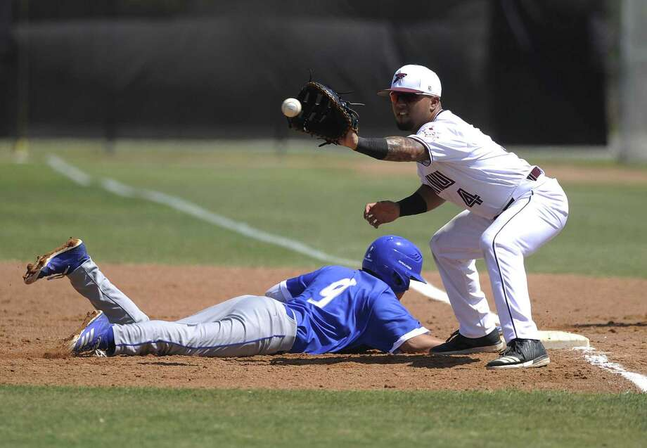TAMIU finished up its 2018 campaign losing 12-0 and 3-2 in a doubleheader at Heartland Conference regular-season co-champion St. Edward's Sunday. First baseman Ricky Gonzalez had one of the Dustdevils' two hits in Game 1 and drove in one of their two runs in Game 2. Photo: Danny Zaragoza /Laredo Morning Times File