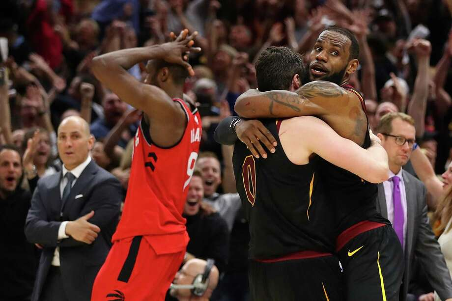 f9e67e845b61 The Cavaliers  LeBron James (right) and Kevin Love celebrate beside  Toronto s Serge Ibaka