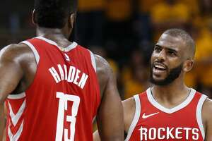 Houston Rockets guard James Harden (13) and Houston Rockets guard Chris Paul (3) embrace during the second half of Game 4 of the NBA second-round playoff series against the Utah Jazz at Vivint Smart Home Arena Sunday, May 6, 2018 in Salt Lake City. (Michael Ciaglo / Houston Chronicle)