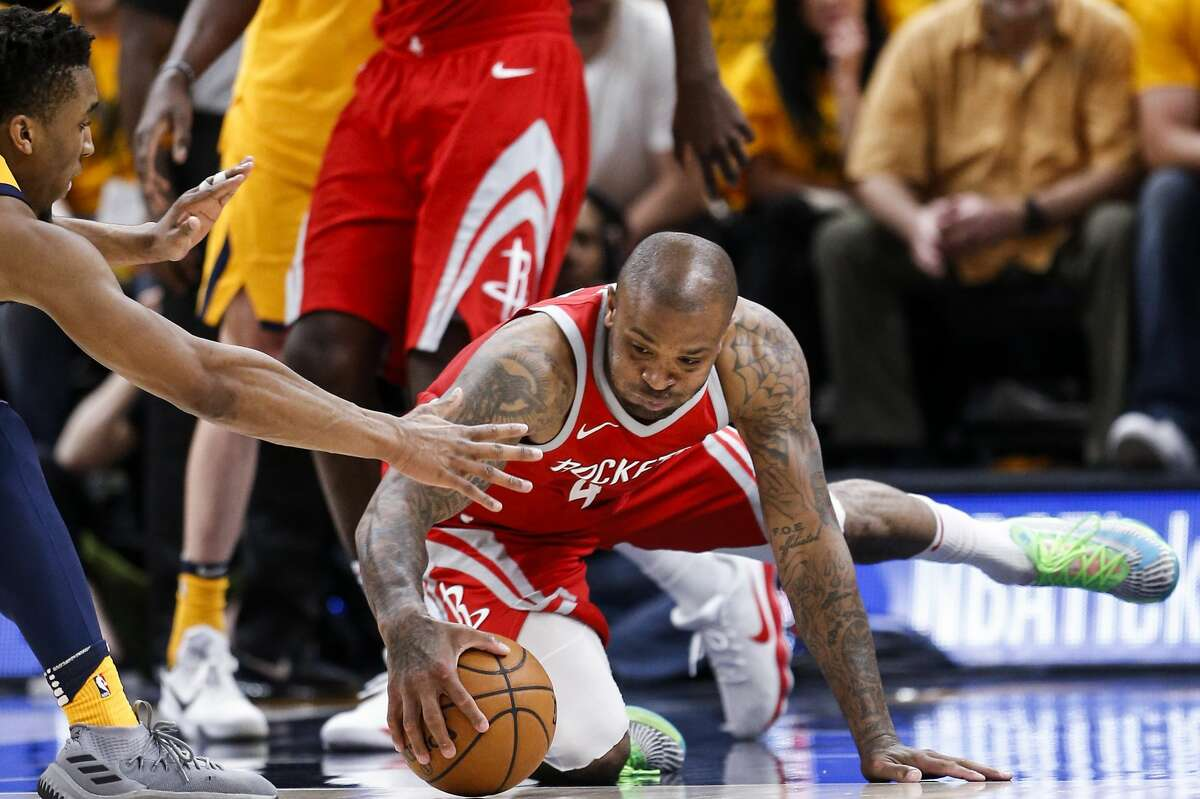Houston Rockets forward PJ Tucker (4) goes after a loosew ball with Utah Jazz guard Donovan Mitchell (45) during the second half of Game 4 of the NBA second-round playoff series at Vivint Smart Home Arena Sunday, May 6, 2018 in Salt Lake City. (Michael Ciaglo / Houston Chronicle)