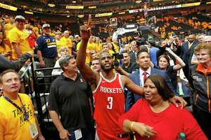 Houston Rockets guard Chris Paul (3) celebrates the team's victory as he leaves the court following Game 4 of an NBA basketball second-round playoff series against the Utah Jazz, Sunday, May 6, 2018, in Salt Lake City. The Rockets won 100-87. (AP Photo/Rick Bowmer)
