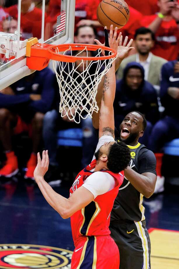 Warriors forward Draymond Green shoots over the Pelicans' Anthony Davis. Green did his usual thing Sunday, nearly registering a triple-double with 8 points, 9 rebounds and 9 assists. Photo: Stephen Lew / Icon Sportswire Via Getty Images / ©Icon Sportswire (A Division of XML Team Solutions) All Rights Reserved
