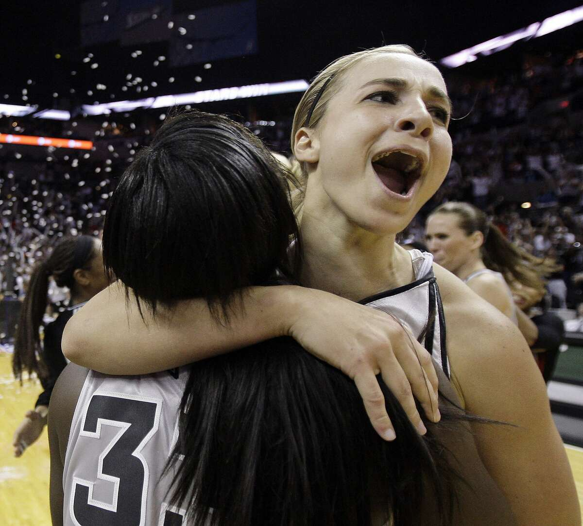San Antonio Silver Stars' Becky Hammon, right, and Vickie Johnson, left, celebrate after defeating the Los Angeles Sparks to win game 3 of the WNBA Western Conference Finals basketball game in San Antonio, Sunday, Sept. 28, 2008. San Antonio won 76-72 and will advance to the WNBA finals. (AP Photo/Eric Gay)