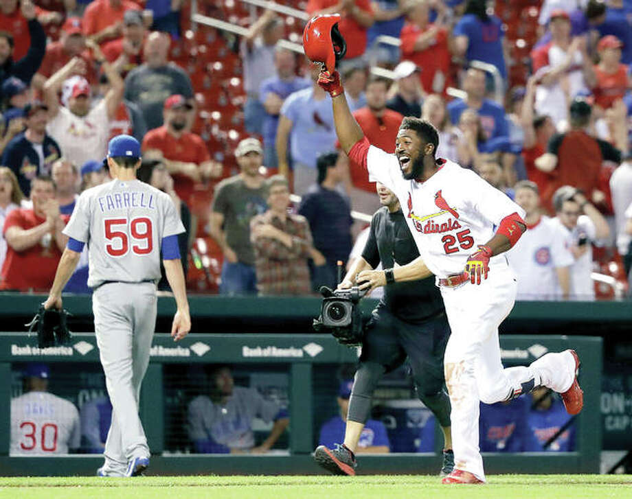 The Cardinals' Dexter Fowler (25) celebrates his walk-off two-run home run off Chicago Cubs relief pitcher Luke Farrell (59) in the 14th inning of Sunday night's game at Busch Stadium. The Cardinals won 4-3. Photo:     Charles Rex Arbogast | AP Photo