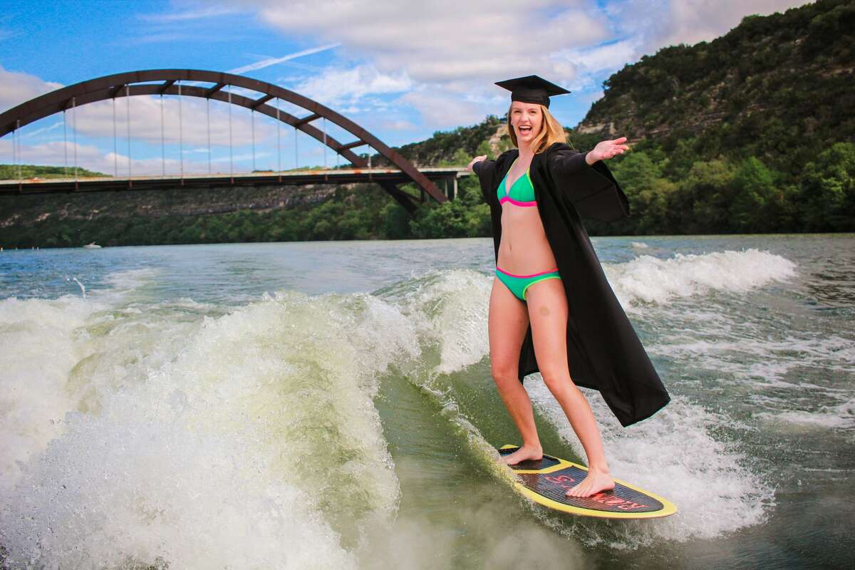 Carly Morris, a senior at the University of Texas in Austin, took her senior photos while wakeboarding.Scroll ahead to see more photos from the shoot.
