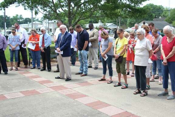 Citizens of San Jacinto County bow their heads for the National Day of Prayer at the Coldspring courthouse on May 3.