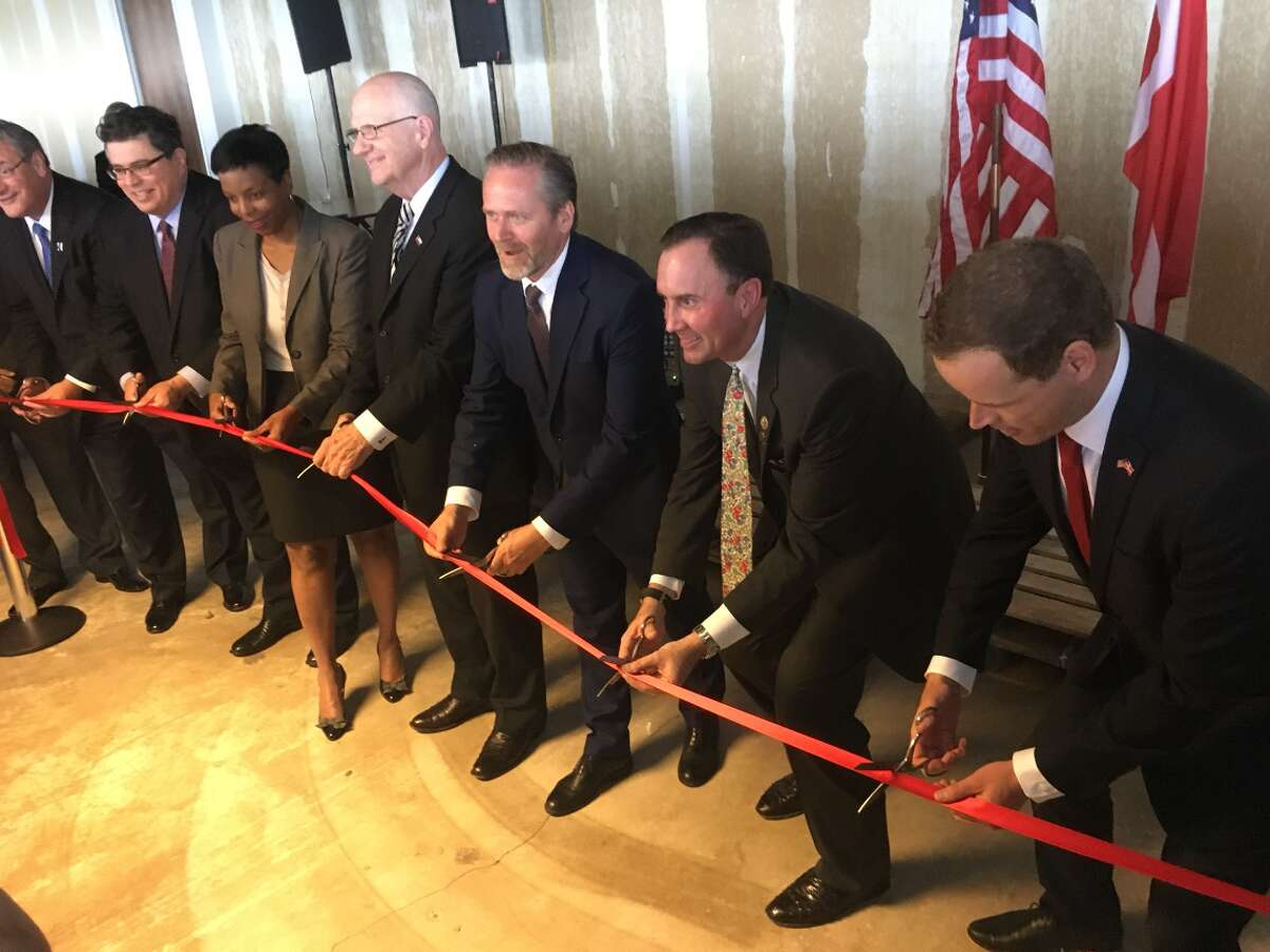 Anders Samuelsen, third from right, Minister for Foreign Affairs of Denmark, cuts the ribbon for the new Consulate General in Houston. Photo provided by theMinistry of Foreign Affairs of Denmark .