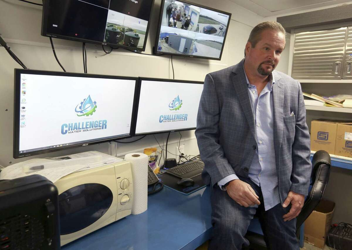 Clint Layman talks Dec. 5, 2017 inside the control room of Challenger Water Solutions' water recycling system demonstration facility. Consisting of two containers that do the actual water cleaning and a third container used as a control room, the entire system can be transported on two semi trucks.