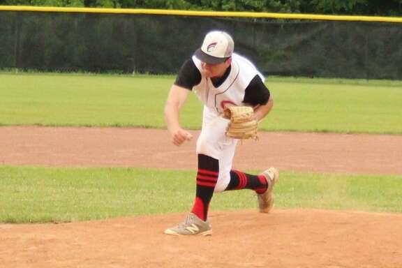 Coldspring-Oakhurst Trojan Brendan Beard throws a pitch at a Corrigan-Camden Bulldog during the May 4 baseball game.