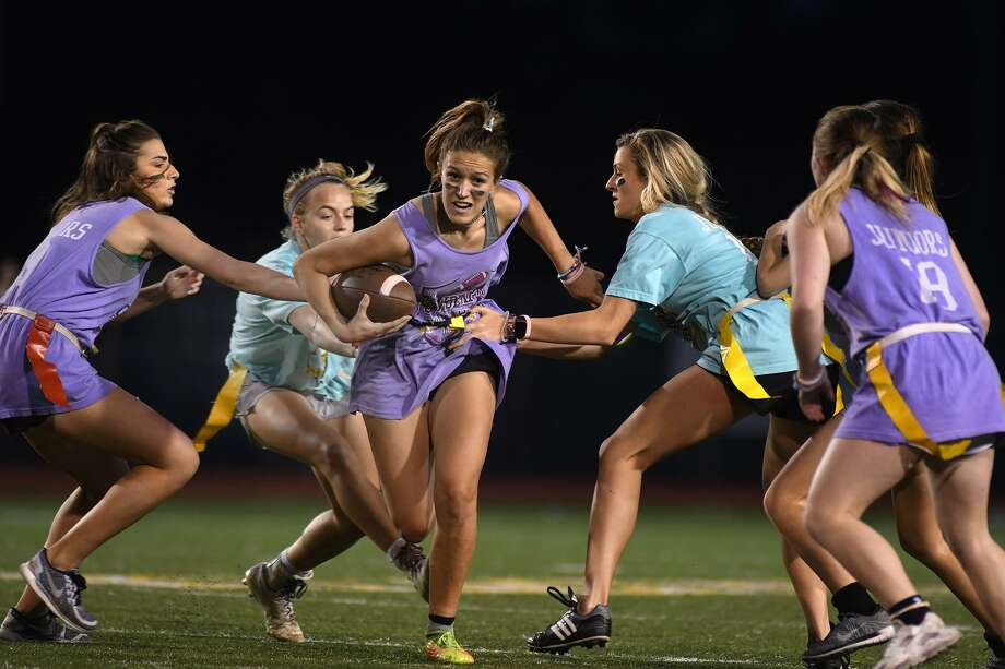 Klein Oak Juniors running back Kaylee Purtee, center, works for yardage against Hailey Moore, left, Emily Cole, right, the Klein Juniors defense during their matchup at the Klein Rivals Powder Puff Tournament at Klein Memorial Stadium on May 4, 2018. (Photo by Jerry Baker/Freelance) 4, 2018. (Photo by Jerry Baker/Freelance) Photo: Jerry Baker, Freelance / For The Chronicle / Freelance