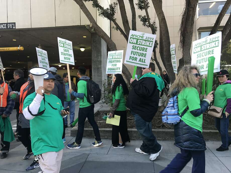 Hundreds of workers affiliated with the American Federation of State, County and Municipal Employees Local 3299 walked off the job at UCSF's Parnassus Avenue medical center on Monday. Union members are protesting the university's proposed contract. Photo: Sarah Ravani