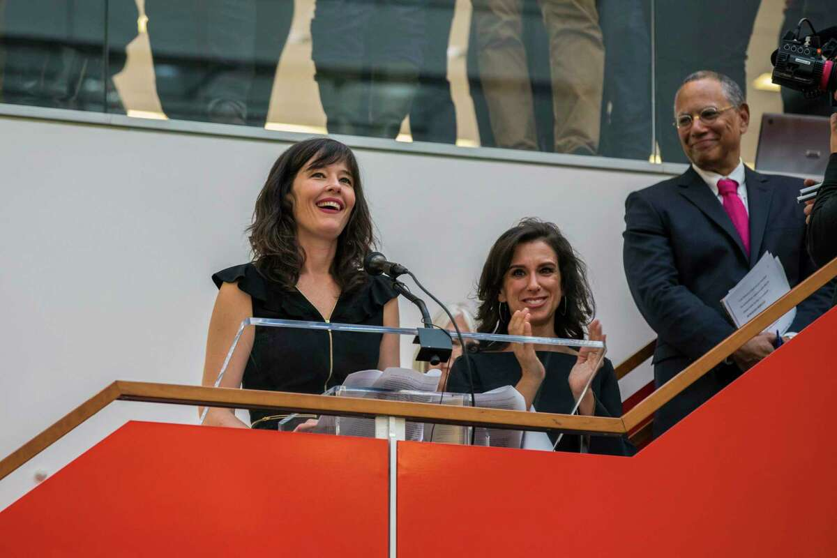 As New York Times Executive Editor Dean Baquet looks on, staff writers Megan Twohey, left, and Jodi Kantor address colleagues in the newsroom in New York after the team they led won the 2018 Pulitzer Prize for Public Service on Monday, April 16, 2018. The Times shared the prize with Ronan Farrow of The New Yorker for their reporting on sexual harassment that ushered in a reckoning about the treatment of women by powerful men in the uppermost ranks of Hollywood, politics, media and technology.