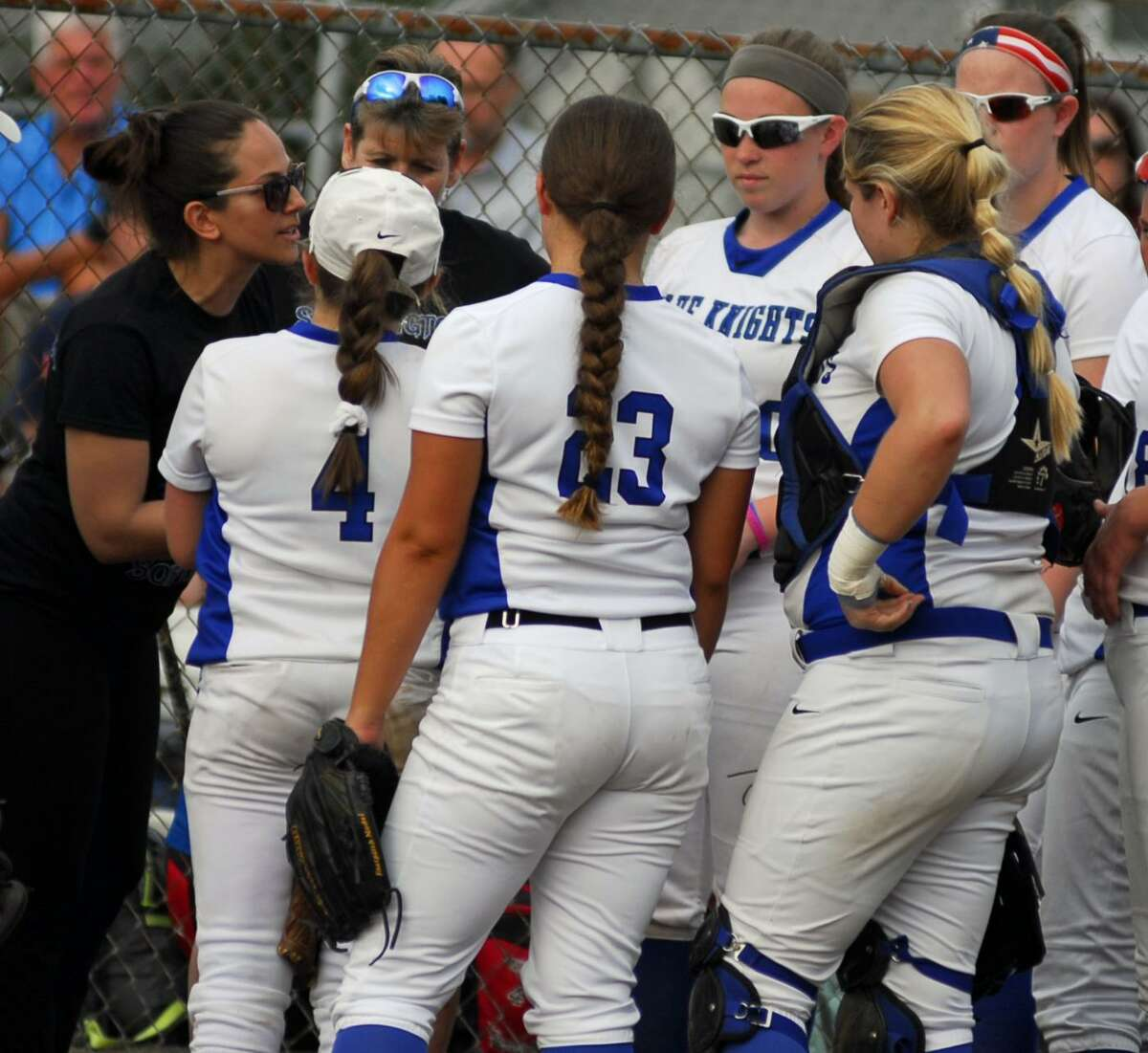 Southington coach Davina Hernandez, left, addresses her team during a game against Fitch on Friday.