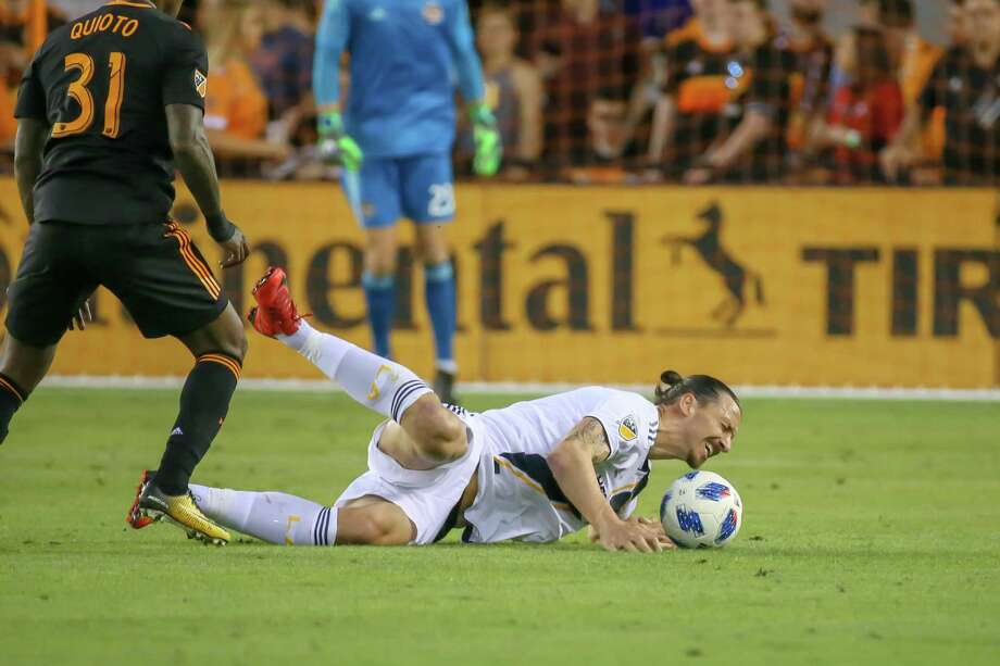 May 5, 2018:  Los Angeles Galaxy forward Zlatan Ibrahimovic (9) goes to the ground after colliding with Houston Dynamo forward Romell Quioto (31) during the MLS soccer match between the LA Galaxy and Houston Dynamo at BBVA Compass Stadium in Houston, Texas.  (Leslie Plaza Johnson/Freelance Photo: Leslie Plaza Johnson, Freelancer / For The Chronicle / Freelance