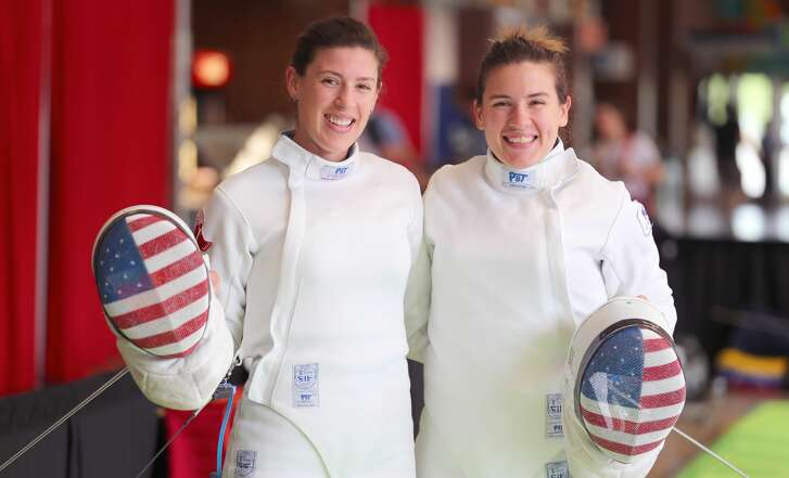 MONTREAL, CANADA - JUNE 13:   American Sisters Kelley Hurley (left) and Courtney Hurley pose for the camera during warm-up for the Women's Epee event on June 13, 2017.  The Hurley's would take 1st and 2nd in the event at the Pan-American Fencing Championships at Centre Pierre-Charbonneau in Montreal, Quebec, Canada. (Photo by Devin Manky/Getty Images)