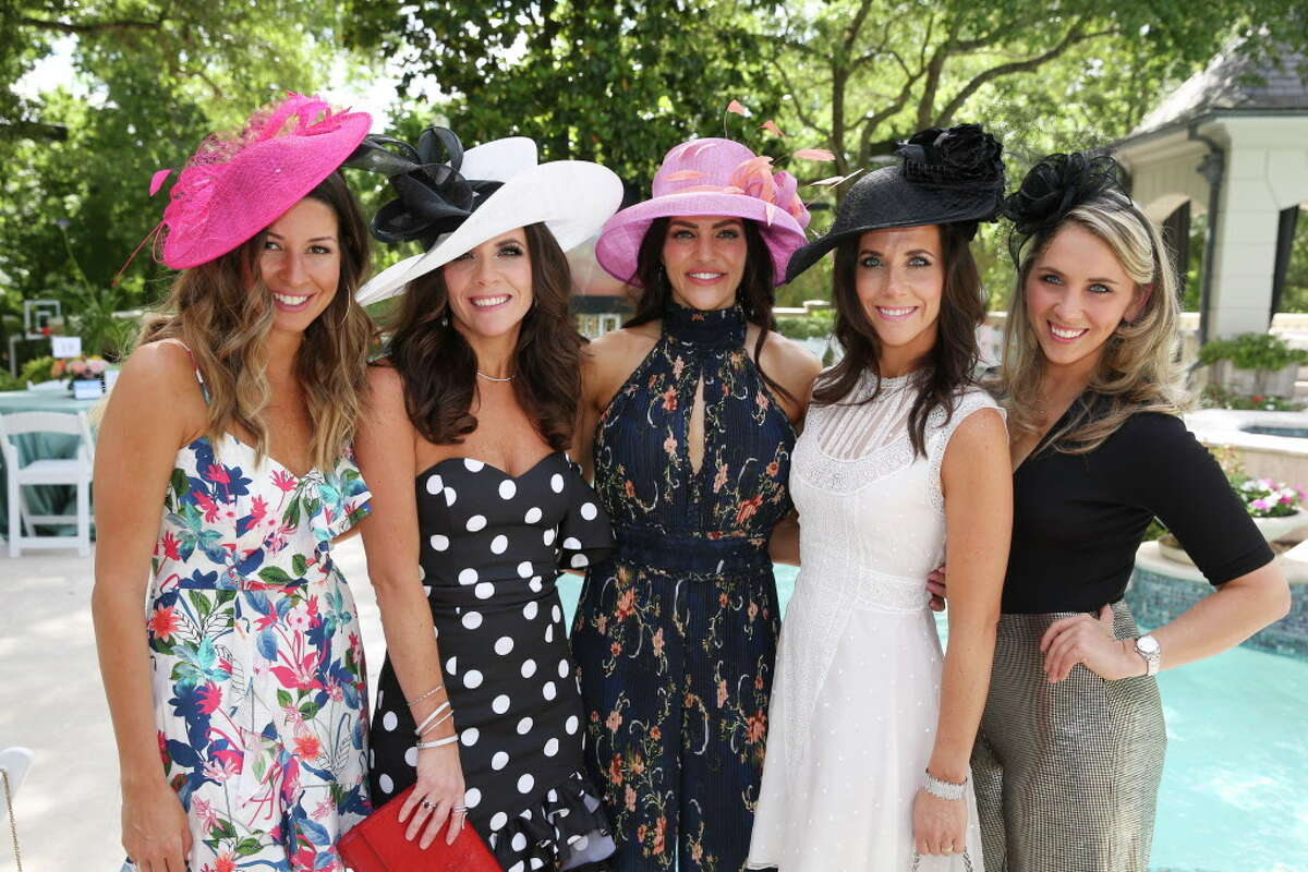 Caroline Walter, from left, Joanna Marks, Megan Cushing, Hannah McNair and Bethany Hibbetts pose for a photograph at the 2nd Annual Hats, Hearts & Horseshoes benefiting Bo's Place on Saturday, May 5, 2018, in Houston.