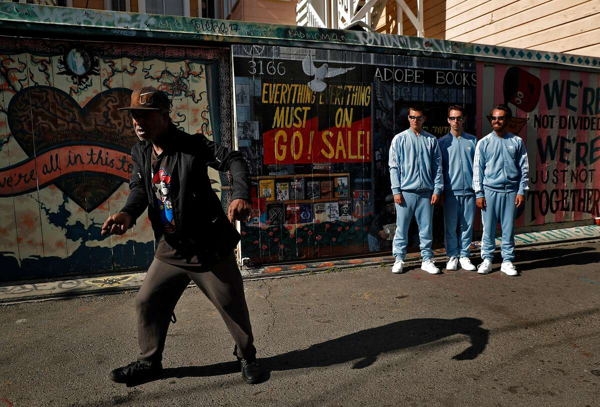 Rico Coleman, a local resident, dances with, l-r, Nathaniel Moore, Ben Needham-Wood, and Choreographer Alexander Ekman in Clarion Alley during a S.F. Dance Film Festival video shoot.