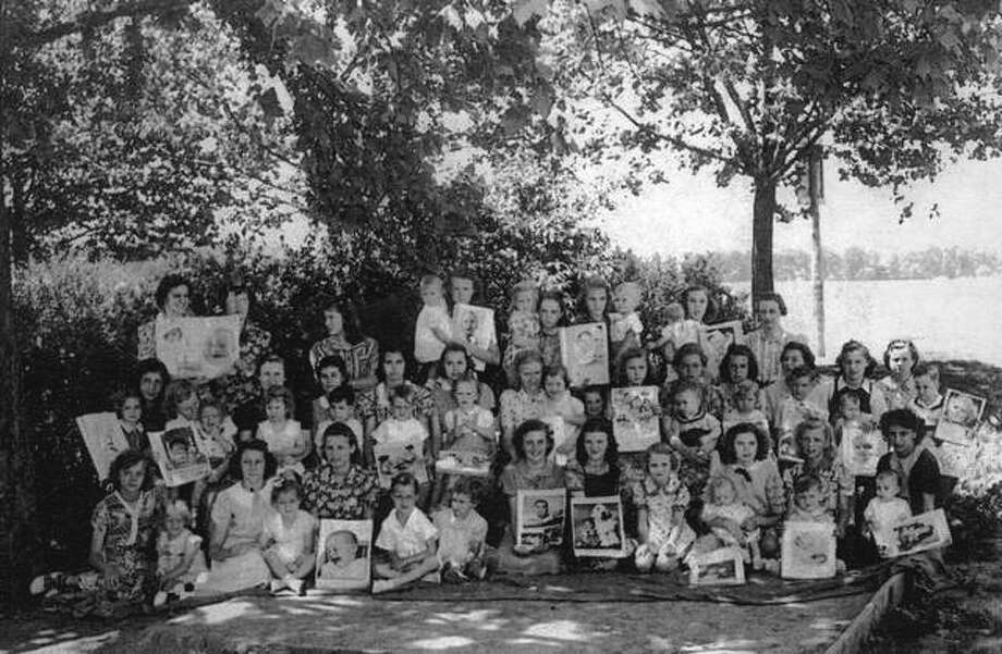 Miss Mabel Ditch was a trendsetter when she added real babies to her home economics classes at Woodrow Wilson School in Hartford in 1939. She is standing in the back row on the far right. Among the students were Irene Farnsworth, holding her niece, Virginia Berry, age 7 to 8 months. Miss Ditch continued to teach through 1952 when Virginia graduated. Virginia died just a few days short of her 91st birthday. This photo was featured in the Woodrow Wilson Reunion Memory Book from Virginia's original photo. Duplicates of the Memory Book are available at Hartford Library. They cannot be taken from the library, but people are welcome to have copies made for 25 cents. Photo:       File Photo