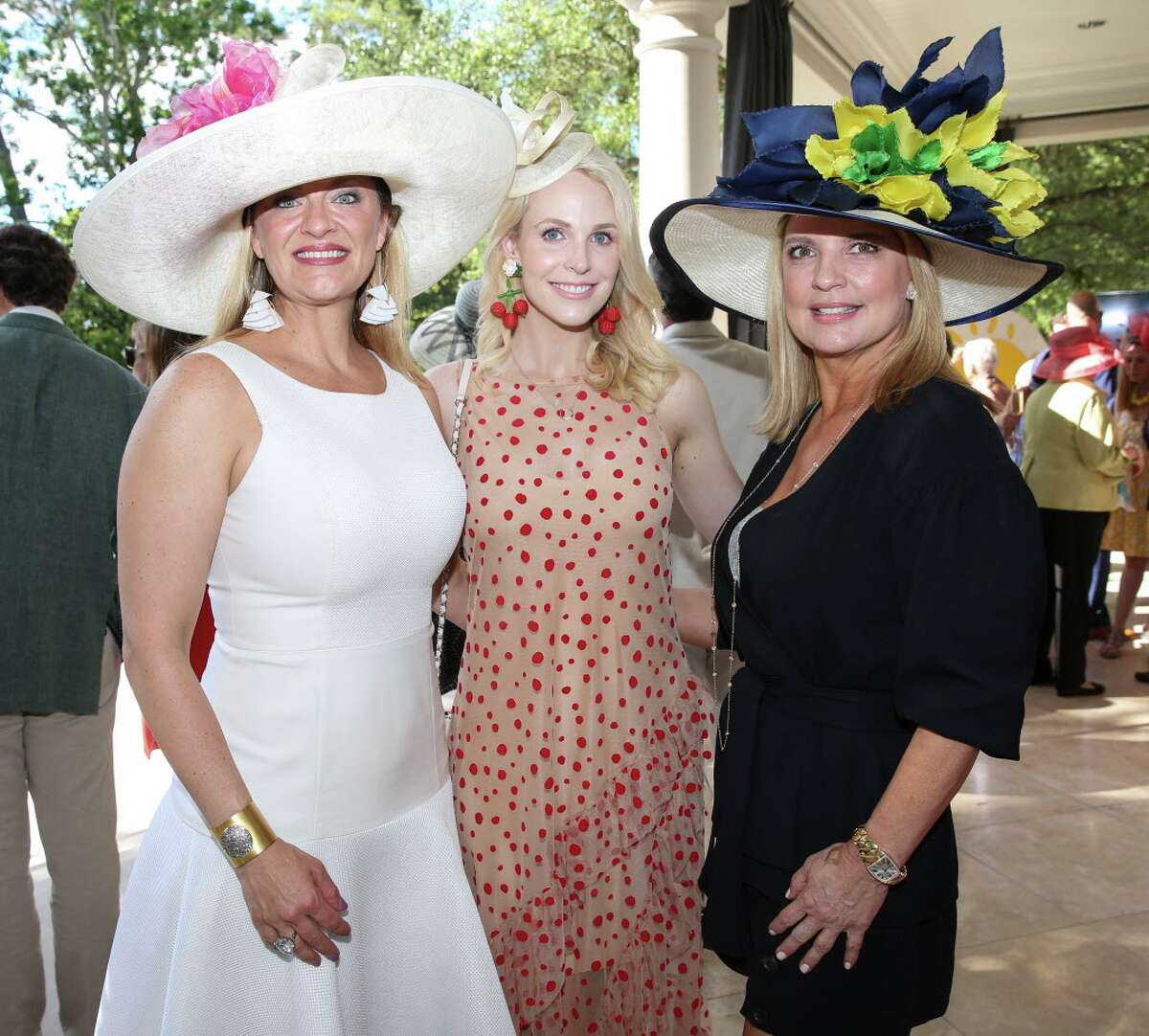 Rachel Regan, from left, Kathleen Jennings and Melissa Juneau pose for a photograph at the 2nd Annual Hats, Hearts & Horseshoes benefiting Bo's Place on Saturday, May 5, 2018, in Houston.
