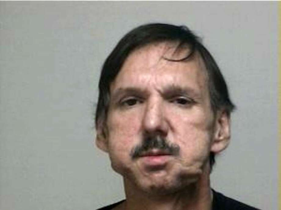 Fairfield police arrested Dane Eisenman,  57, on a warrant Thursday morning, a little more than a month after he paid cash for a .30-06 rifle. After checking his background, police discovered that Eisenman is a convicted felon. As such, he is not allowed to own handguns or rifles. Police said was preparing for an alien invasion. Police issued a warrant for Eisenman's arrest, and he turned himself in about 11:15 a.m. Thursday on a charge of criminal possession of a firearm. Eisenman was released on a promise to appear July 9 in Bridgeport Superior Court. Photo: Contributed Photo / Connecticut Post Contributed