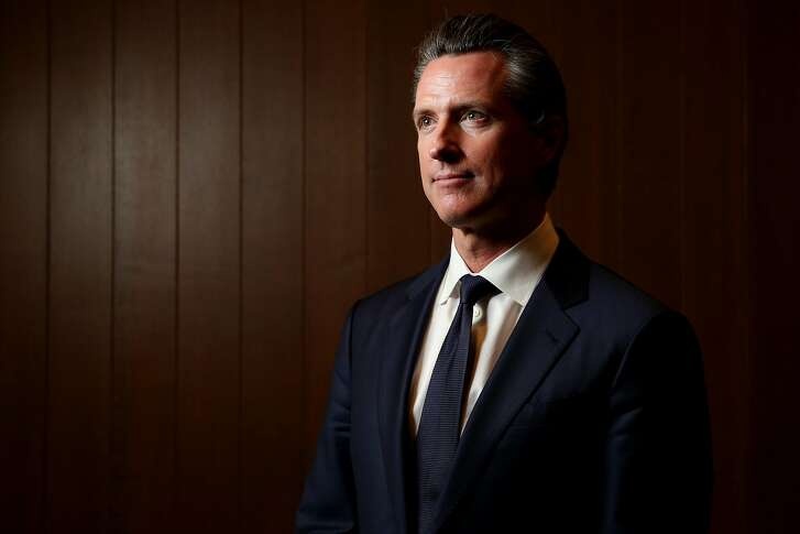 California Lt. Gov. Gavin Newsom stands for a portrait before an interview with the San Francisco Chronicle editorial board, Wednesday, April 18, 2018, in San Francisco, Calif.