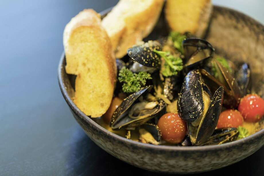 Mussels a la plancha, a dish from chef Dominick Lee at Poitin Photo: Trevor Gerland / Trevor Gerland