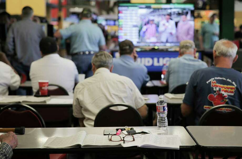 Along with those who show up for only for Derby Day, many regular patrons and racing fans focus less on the party and more on the simulcast from Churchill Downs as well. Photo: Elizabeth Conley / © 2018 Houston Chronicle