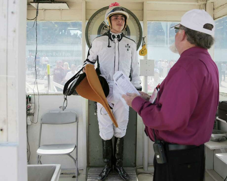 Ricardo Garza-Cruz weighs in after placing in the top four during a race. The weight of a jockey usually ranges between 108 and 118 pounds. Photo: Elizabeth Conley / © 2018 Houston Chronicle