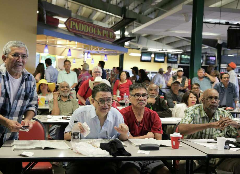 As the Kentucky Derby takes place, patrons, including James Balgos, second from left, react as they watch it on the big screen. Photo: Elizabeth Conley / © 2018 Houston Chronicle
