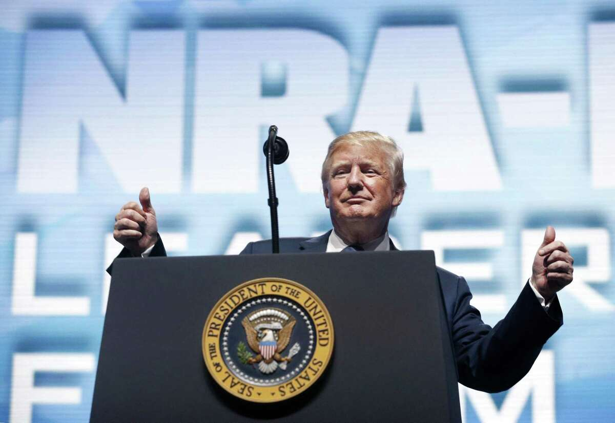 President Donald Trump addresses the NRA Annual Meeting at the Kay Bailey Hutchison Convention Center in Dallas, on Friday, May 4, 2018. The NRA asked its members to boycott a nearby restaurant, Ellen's, which began including a message that advocated for 'reasonable gun regulations' on the bottom of its receipts Friday morning, before the NRA's weekend gathering.
