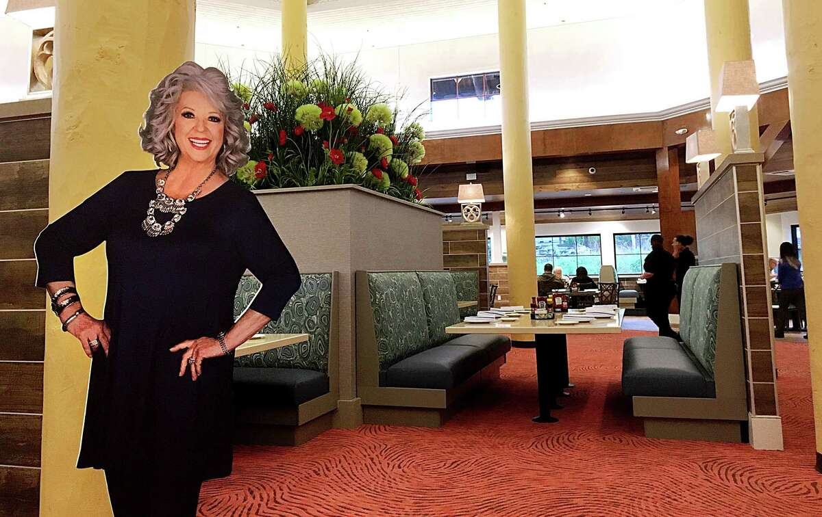 A cutout of Paula Deen greets customers at the towering dining room at Paula Deen's Family Kitchen inside Bass Pro Shops at The Rim in San Antonio.