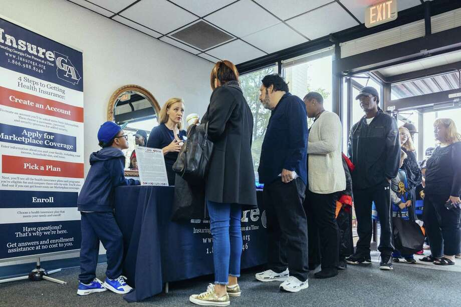 FILE --Amber Higgins, a navigator with Insure Georgia, answers questions and gives out information regarding Affordable Care Act open enrollment at the Child Safety Trick or Treat expo in Macon, Ga., Oct. 28, 2017. The I.R.S. has started sending penalty notices to businesses that failed to comply with the Affordable Care Act's employer mandate, angering Republicans and business groups. Despite Trump's long-standing desire to unwind the signature legislative achievement of his predecessor, many parts of the Affordable Care Act remain in place. Photo: AUDRA MELTON /NYT / NYTNS