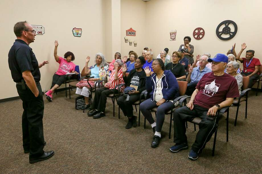 San Antonio Police detective David Brinkman talks about strategies con artists are using to scam seniors by email, phone, postal mail and home visits in a Monday workshop to help seniors detect scams at the Doris Griffin Senior One-Stop Center. Photo: Marvin Pfeiffer /San Antonio Express-News / Express-News 2018