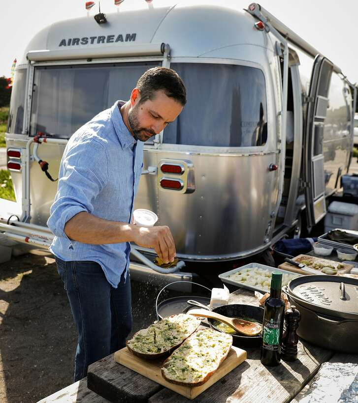 Chef Ethan Mantle puts salt on the garlic bread on Monday, April 9, 2018 in Bodega Bay, Calif.