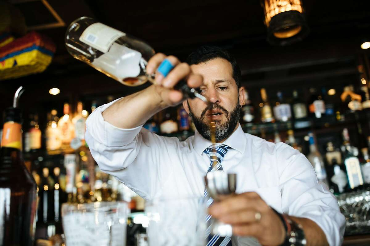 Luis Buenrostro bartender prepares a Mai Tai cocktail at Trader Vic's in Emeryville, Calif., Sunday, April 29, 2018.