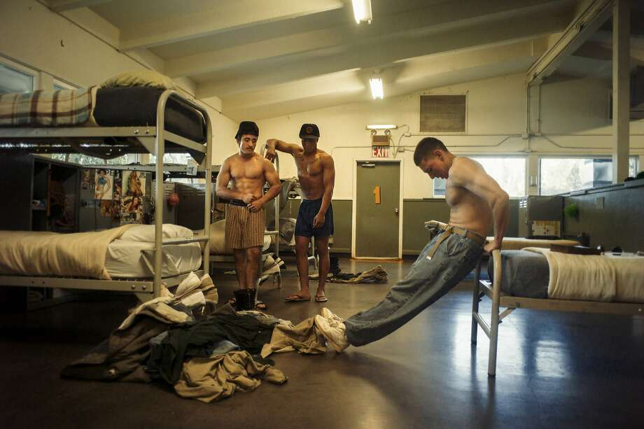 While guards make their hourly head count, inmates of Pine Grove Youth Conservation Camp often work out at their bunks to stay fit for their heavy physical work schedule. Photo: Brian L. Frank / Catchlight Fellow / Marshall Project