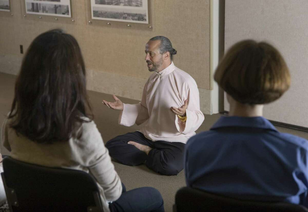 Dr. Alejandro Chaoul, the founding director of the institute, leads a class.